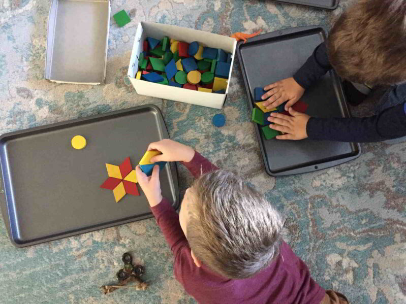 Use wooden pattern blocks to make this simple snowflake art idea. Your kids will love this creative play challenge!