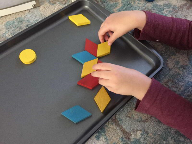 Use wooden pattern blocks to make this simple snowflake activity. Your kids will love this creative play challenge!