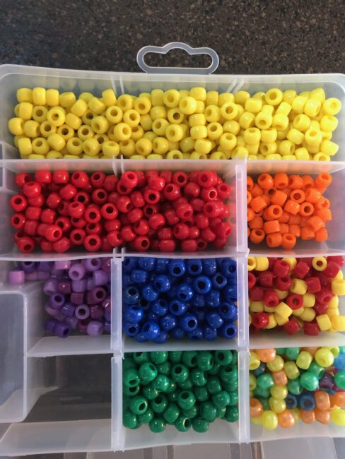 Pony beads are great for fine motor activities for toddlers and preschoolers.