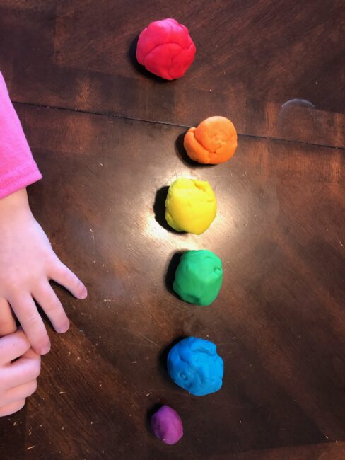 Simple no prep play dough and beads activity for toddlers to learn colors and build fine motor skills using just 2 supplies you have at home.