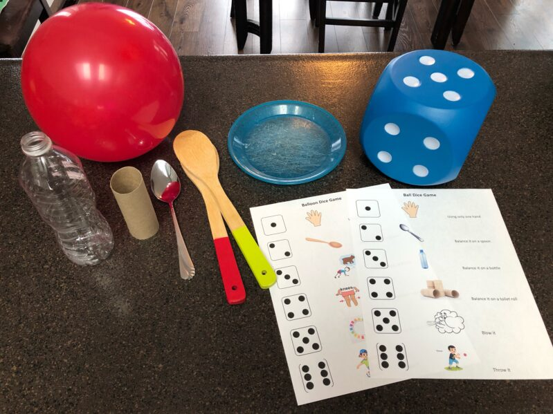 Supplies needed to create your own ball or balloon dice games at home for your kids.