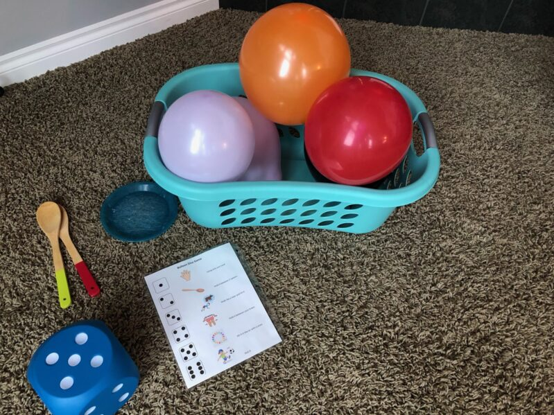 Everything you need to play your own balloon and dice game for kids to get out energy.
