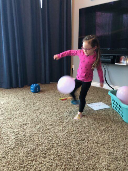 Kicking the balloons