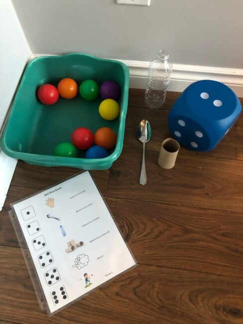 Supplies needed to play ball and dice game.