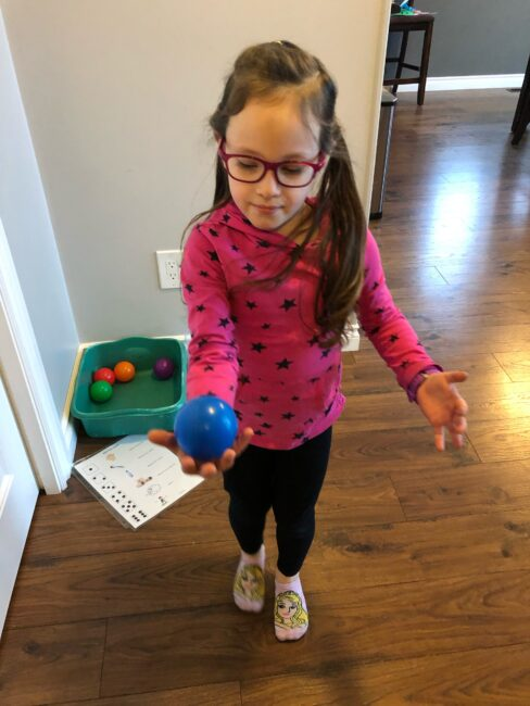 Get your kids moving in this fun and exciting dice game which practices multiple gross motor skills with balls indoors at home.