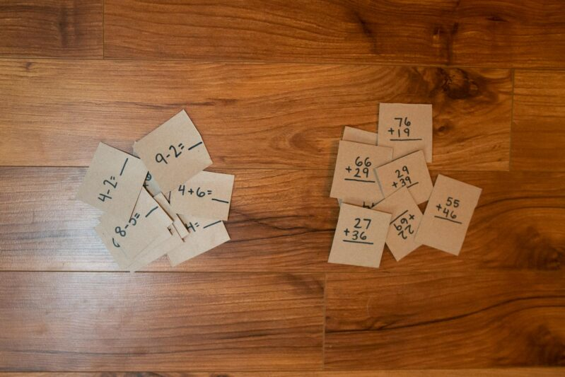 Write math problems on the pack of each piece appropriate for your child's age.