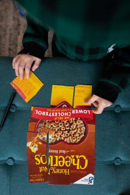 Turn a cereal box into a super simple DIY puzzle activity with a twist.