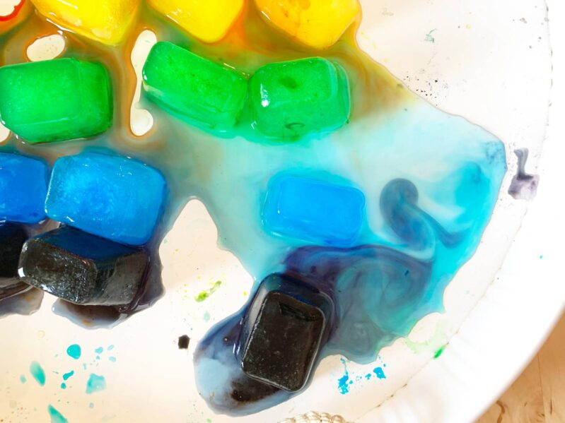 melting and color blending with rainbow ice sensory play