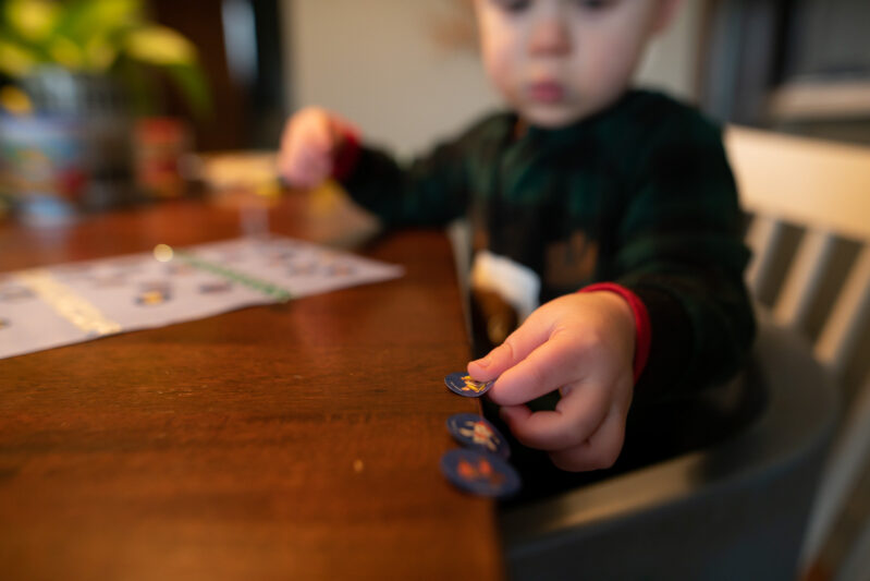 Peel off stickers and line them up on the edge of table if your toddler is having trouble peeling them.