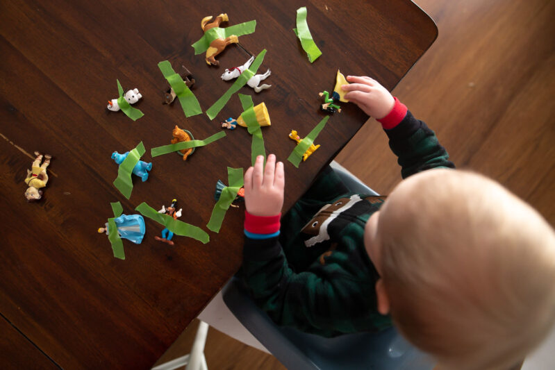 Rescue toy animals by pulling tape in this super simple fine motor activity that's perfect for toddlers and preschoolers both to do at home!