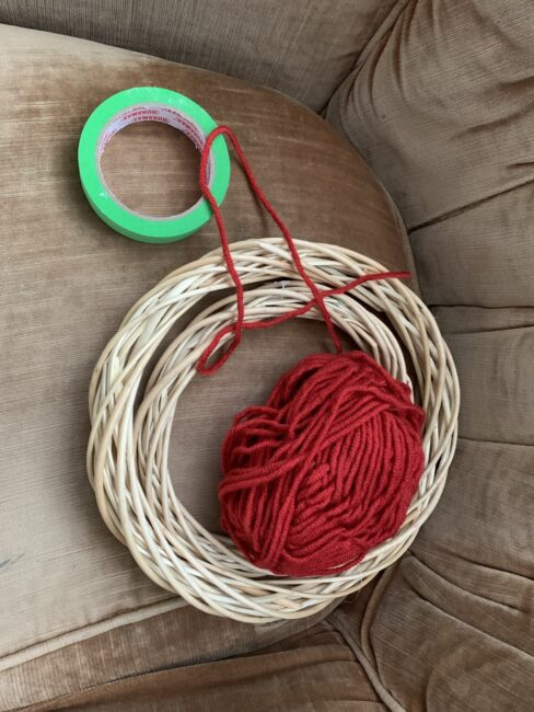 Supplies needed to make a quick and simple hanging target for launching pom poms at.