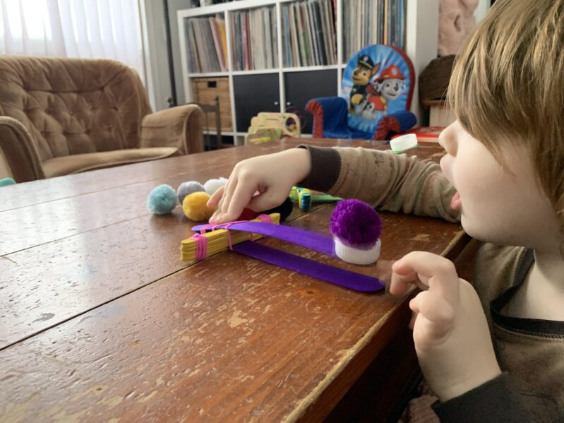 Quick and easy DIY homemade pom pom catapult activity for young kids with no glue or wait time! Put it together and start to play in minutes!