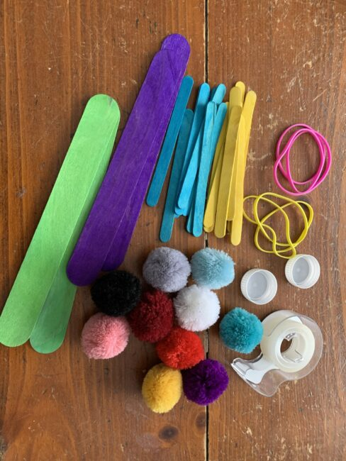 Supplies needed to make your own pom pom catapult in minutes.