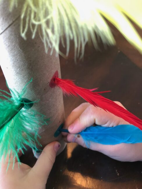 Feather poke fine motor color activity for toddlers and preschoolers.