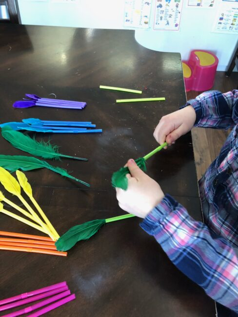 Simple feather and straws color matching threading activity for toddlers and preschoolers at home.