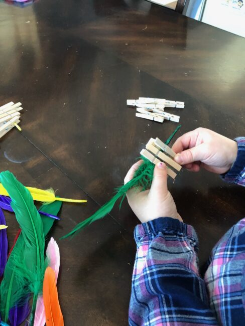 Feathers and clothespins are perfect for fine motor activity exploration.