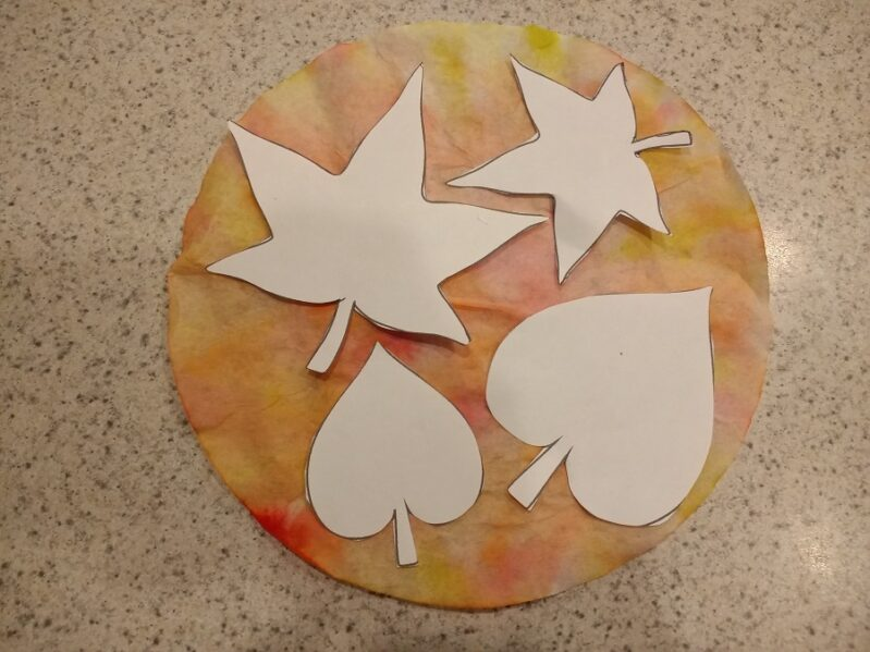 Bring the beautiful colors of the fall season into your home with this easy coffee filter autumn leaves craft simple enough for preschoolers