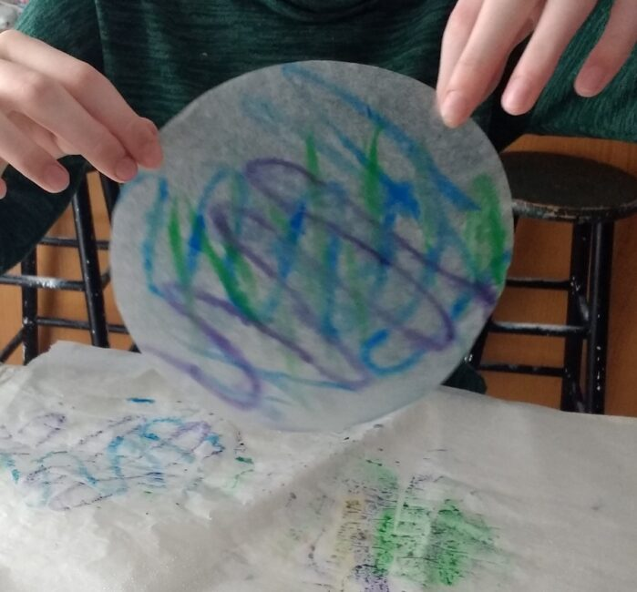 painting coffee filters for autumn leaf craft for kids