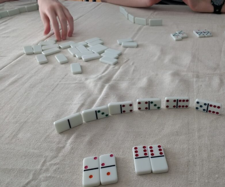 Grab domino tiles and your children and try out 3 fun learning math games at home with these hands on activity ideas using only dominoes.