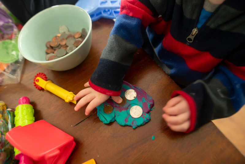 Toddler money exploration math sensory play that is super simple and adaptable for any age!