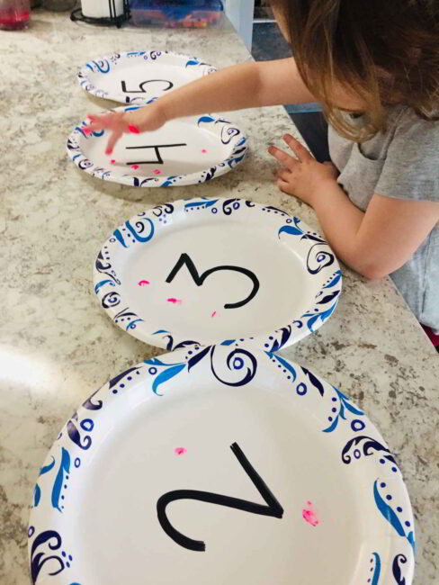 Try this simple preschool number activity and count with finger paint prints!