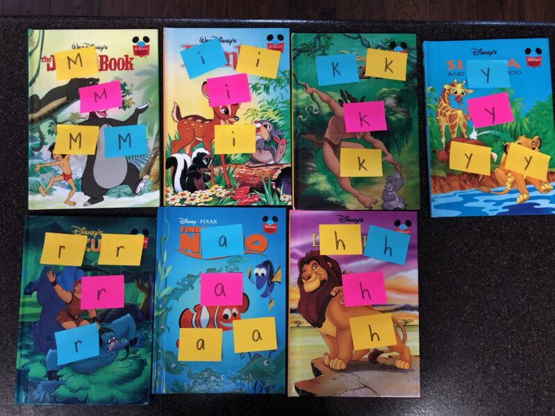 sort sticky note letters onto books.