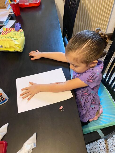 Make a tree trunk and branches by painting and stamping your child's arm and fingers