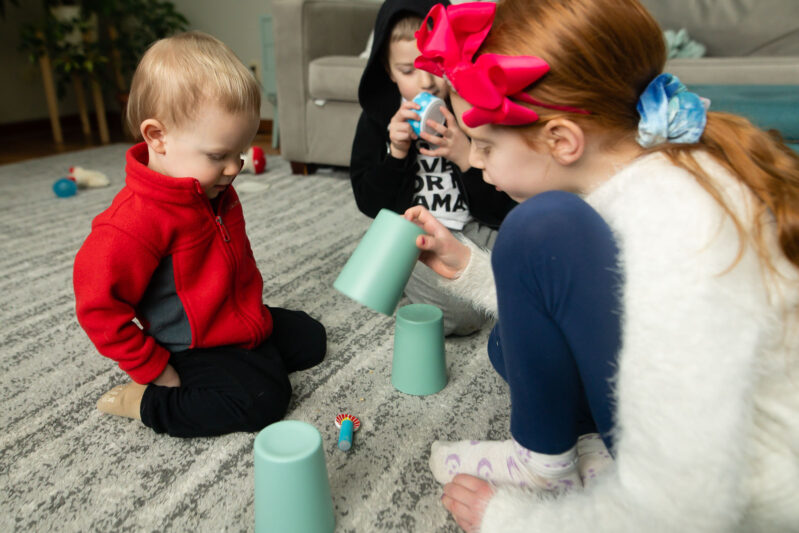 Encourage cognitive development in toddlers with this fun, no-prep, and simple toy and cup memory game that using supplies you have at home.