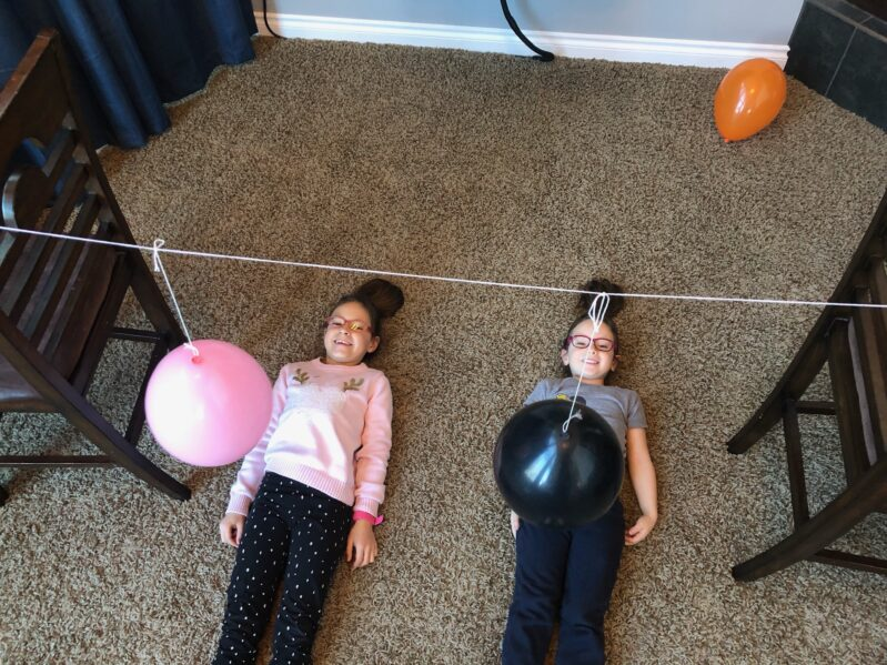 Here are 2 super simple and fun balloon games for kids to play indoors using household supplies and their feet instead of their hands!