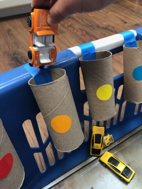 Give playing cars with your toddlers a new and exciting learning twist with these 2 easy activities that use recyclable cardboard tubes!