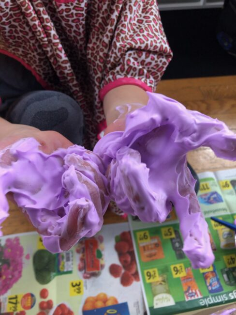 These girls love getting their hands dirty with shaving foam sensory activities!