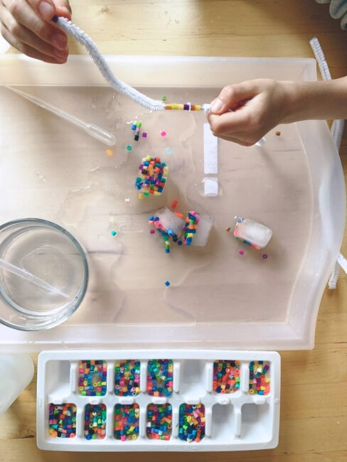 Take fine motor and sensory to a new level with this easy and fun threading beads activity for preschoolers that uses ice!