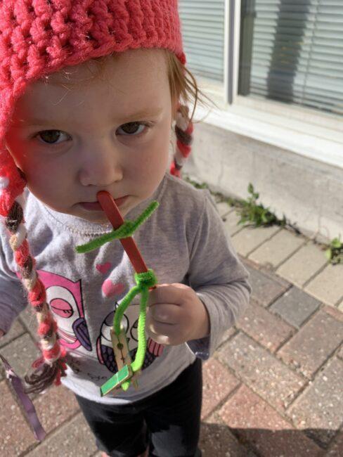 Maisie kissing her Stick Sidekick