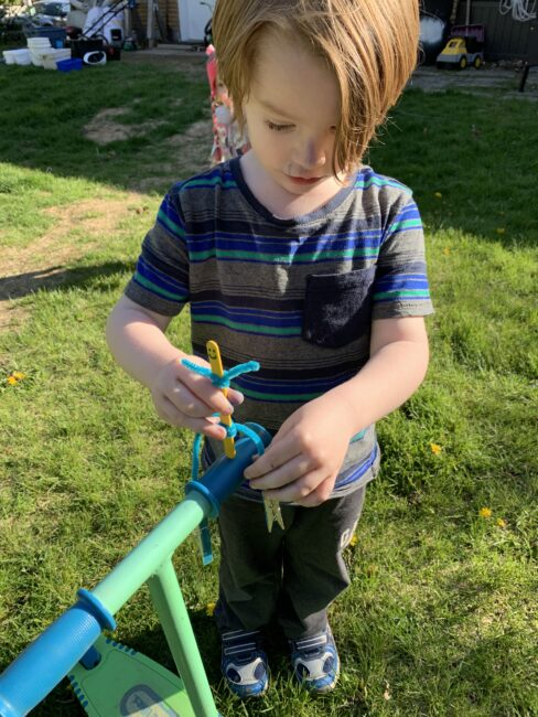 A simple fun kids balancing stick sidekick activity that's an easy center of gravity experiment for toddlers and preschoolers to do at home.
