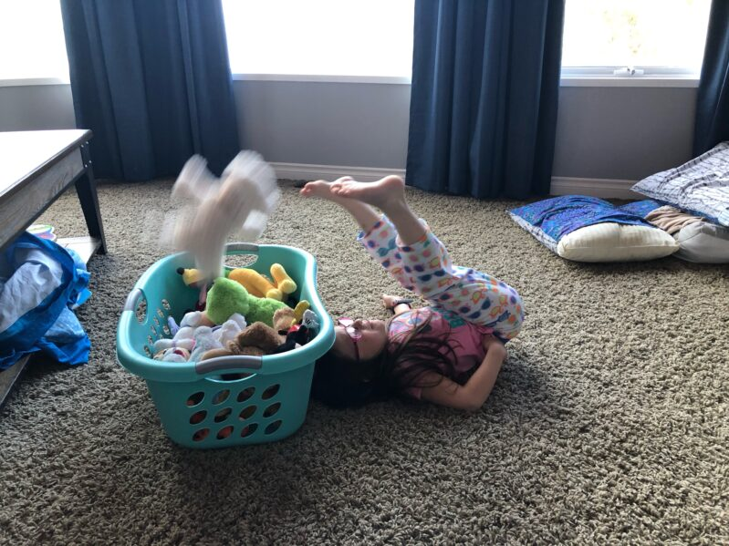 Transfer soft toys (teddy bears or other stuffed animals work great) from the floor over your body and into the laundry hamper.
