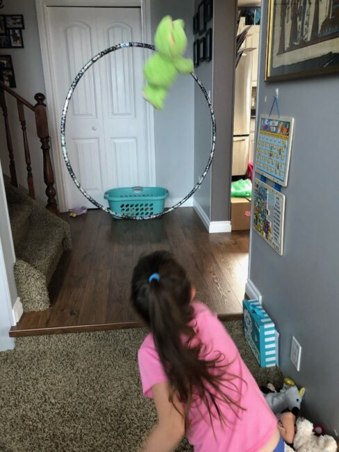 Stuffed Animal Game 2: Target Toss - hang a hula hoop in a doorway or hallway, toss soft toys from one side through the hula hoop and into a laundry basket! Can you hit the target?