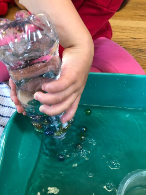 This marble sensory activity is perfect for free play for preschoolers to stay busy and quiet while improving fine motor. Bonus, zero-prep!
