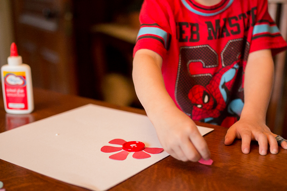 Start out by sorting one color onto the paper and then glue it all down. This is excellent fine motor skills practice for little ones