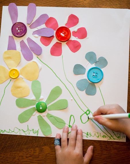 Teach preschoolers colors with this simple hands-on spring flower color match activity and craft that is so easy to do at home with your kids.