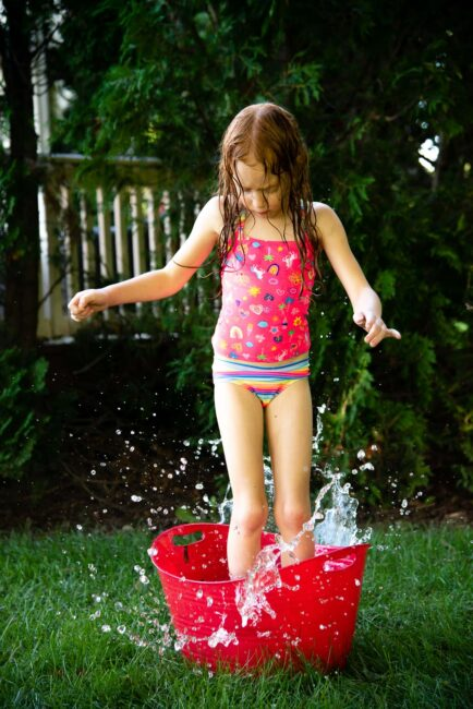 Water play is year-round fun, but nothing beats playing in it outdoors when it is hot. So on a particularly scorching summer day, set up this simple and fun water obstacle course in the backyard for your kids!