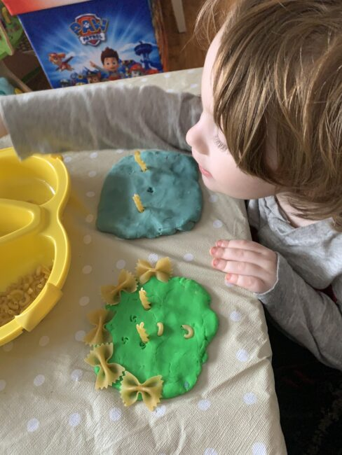 Teach kids about family with this super fun and simple play dough and pasta portraits activity that's perfect for toddlers and preschoolers.