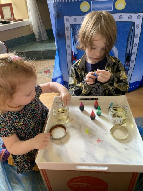 Great fine motor practice part of your space experiment squeezing food coloring into oil jars.