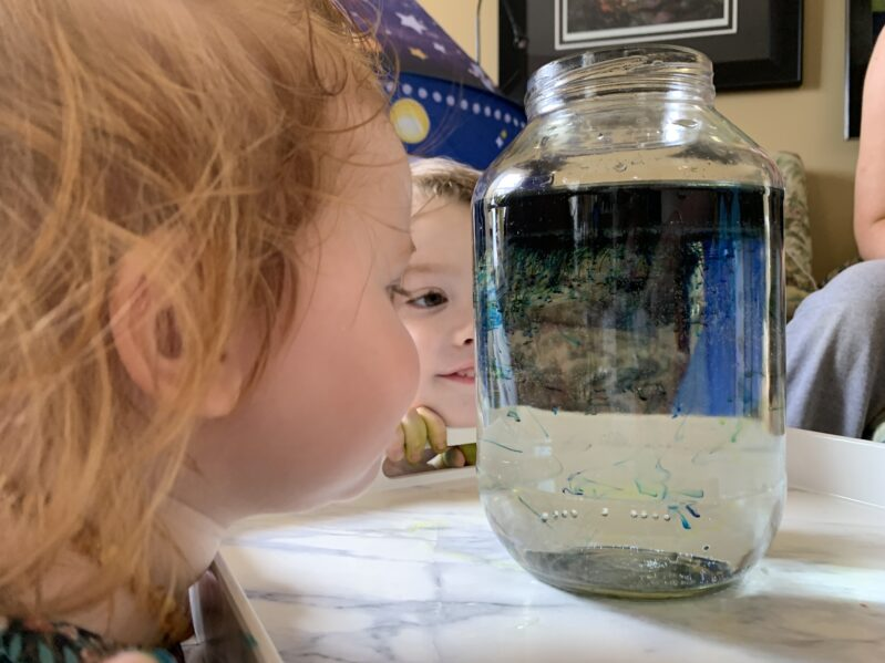 Create a galaxy of shooting stars in a jar space experiment for kids to do at home using simple household supplies from the kitchen!