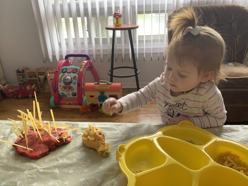 Making play dough and pasta porcupines with toddlers at home for hands on fine motor skills learning.