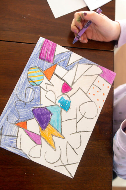 write the letters of the alphabet on a piece of paper to make this chicka chicka boom boom art project