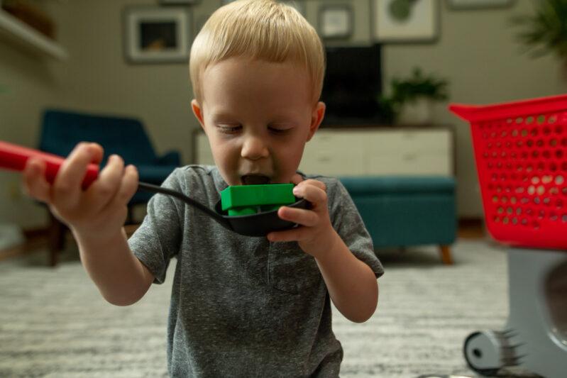 toddler taste testing block soup