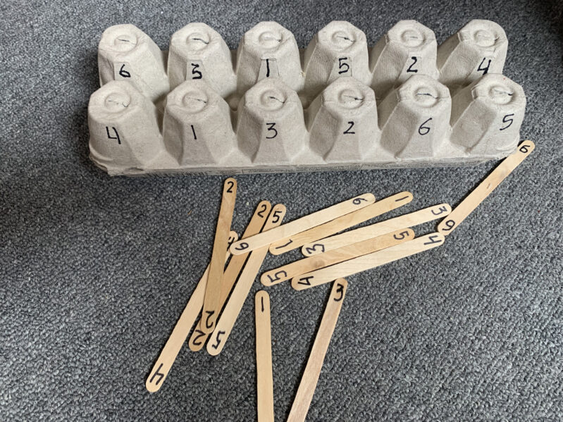 Work on fine motor, color matching, counting, number recognition, or teach upper and lowercase letters with just recycled egg cartons, craft sticks and markers with these simple ideas.