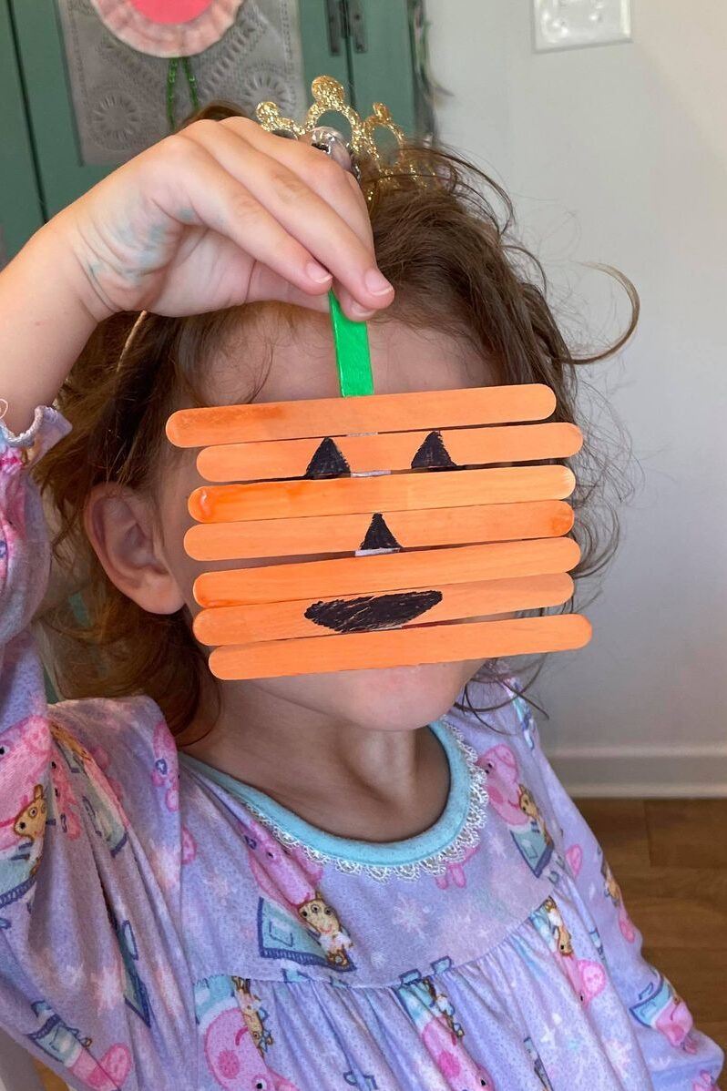 Popsicle stick pumpkin craft and fine motor activity for kids to make and play with - more than just a craft.